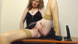 Seductive stepmom in stockings masturbates with a toy