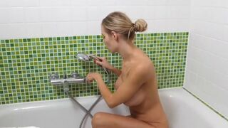 Seductive stepmom with big tits in the shower